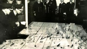 King George VI, 2nd left, in the plot room at Naval HQ in Portsmouth