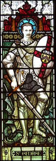 Stained glass window in Trimley Church depicting Herbert St George