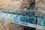 The glass bridge's first customer; a little slippery but not afraid of heights
